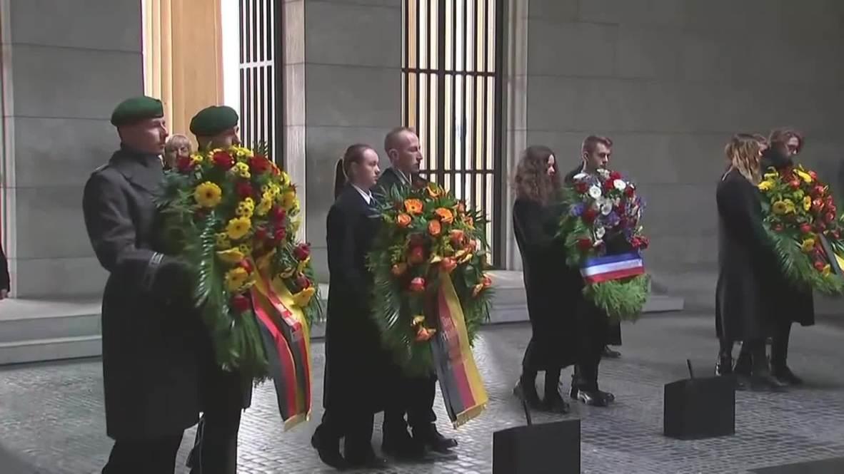 Germany: Merkel, Macron, Steinmeier lay wreaths at Berlin memorial
