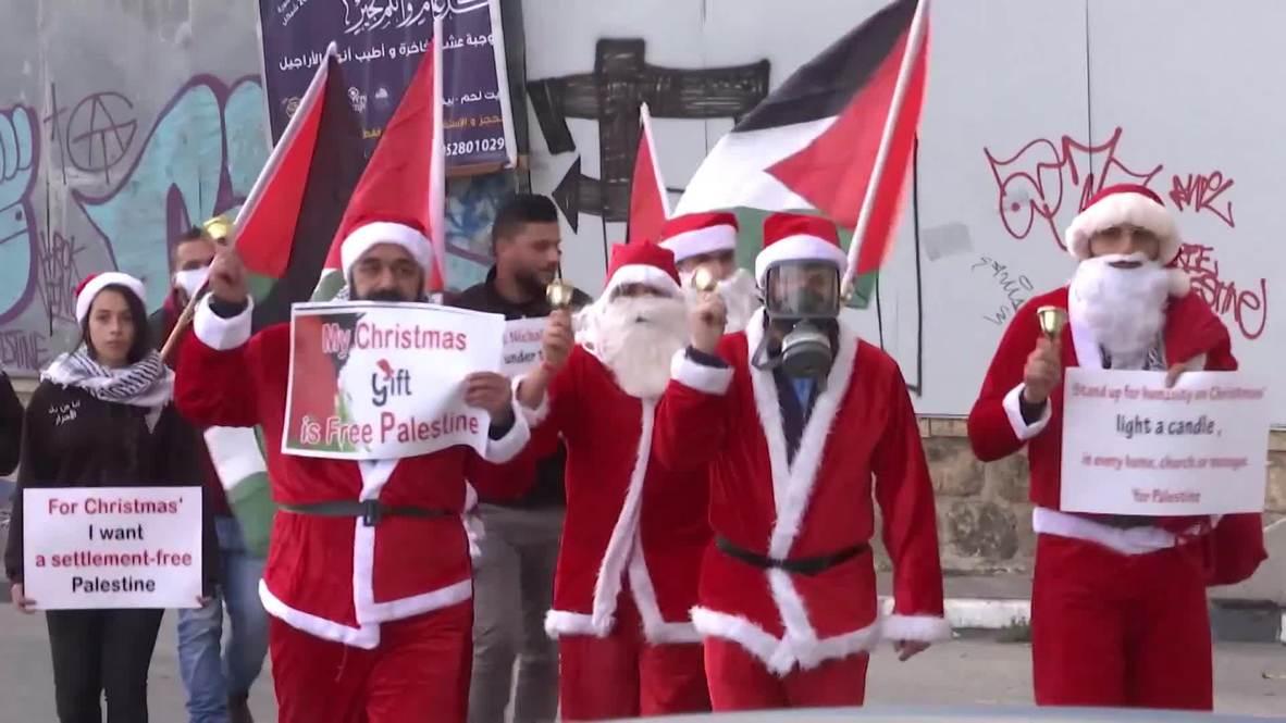 Palestina: Palestinos disfrazados de Papá Noel protestaron contra el muro de separación en Belén