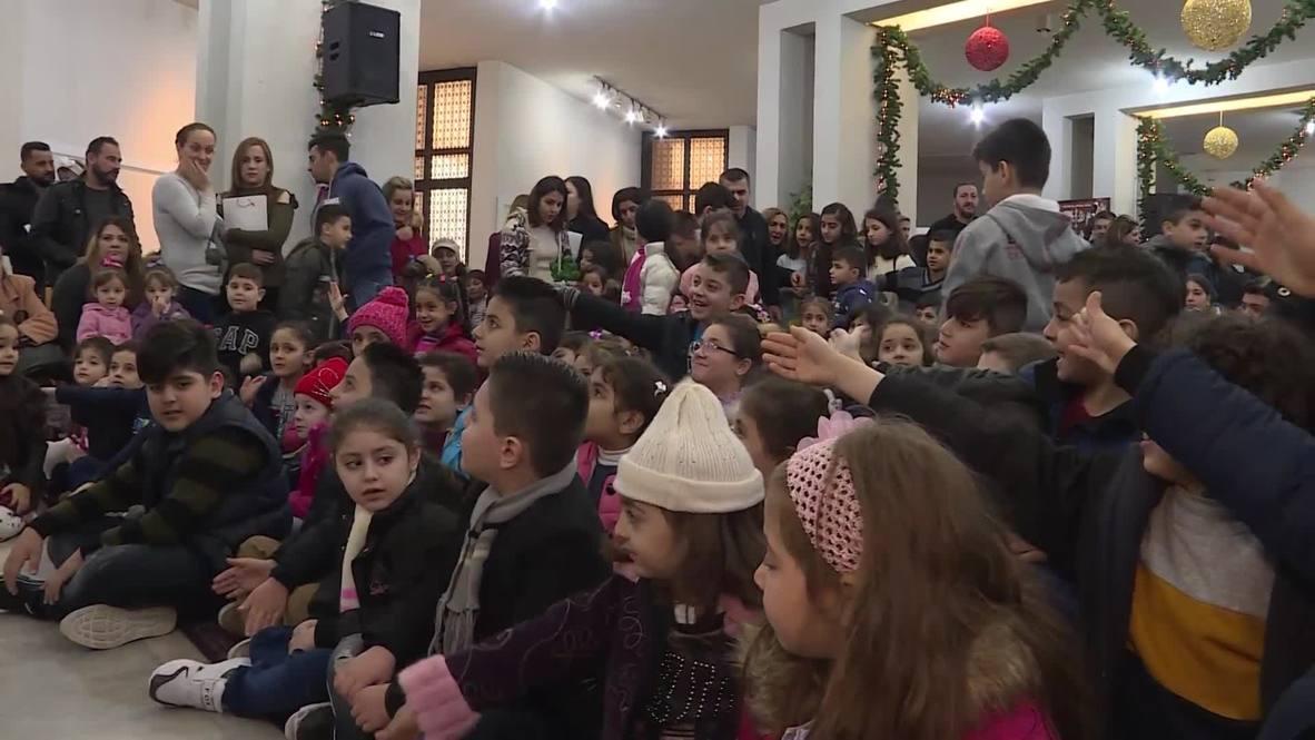 Lebanon: Iraqi refugees gifted presents for Epiphany