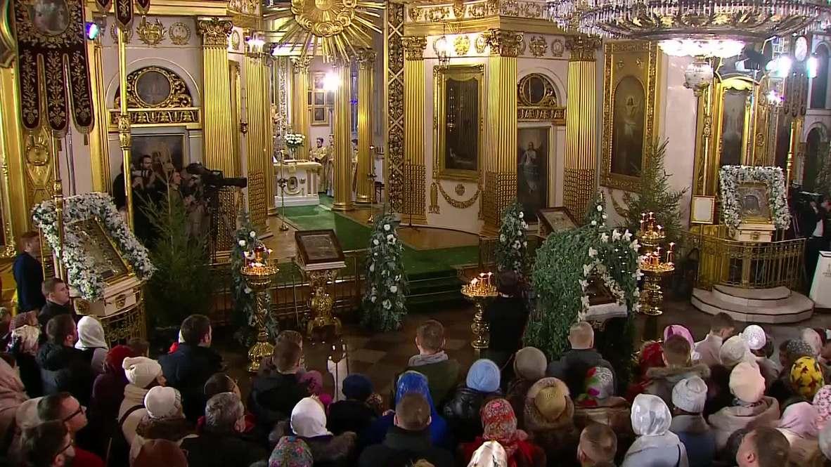 Russia: Putin visits Christmas Mass in his hometown
