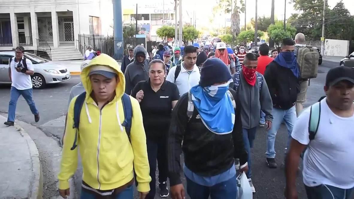 El Salvador: Hundreds of migrants join new caravan heading north