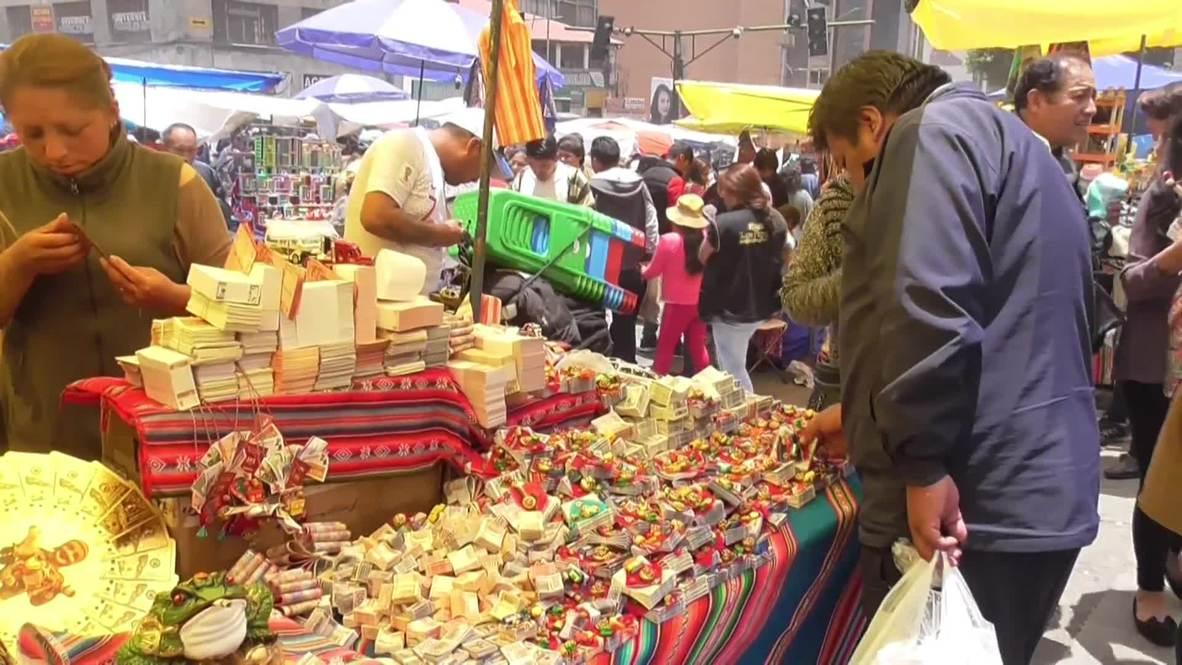 Bolivians celebrate Alasitas fair to honour ancient god of prosperity