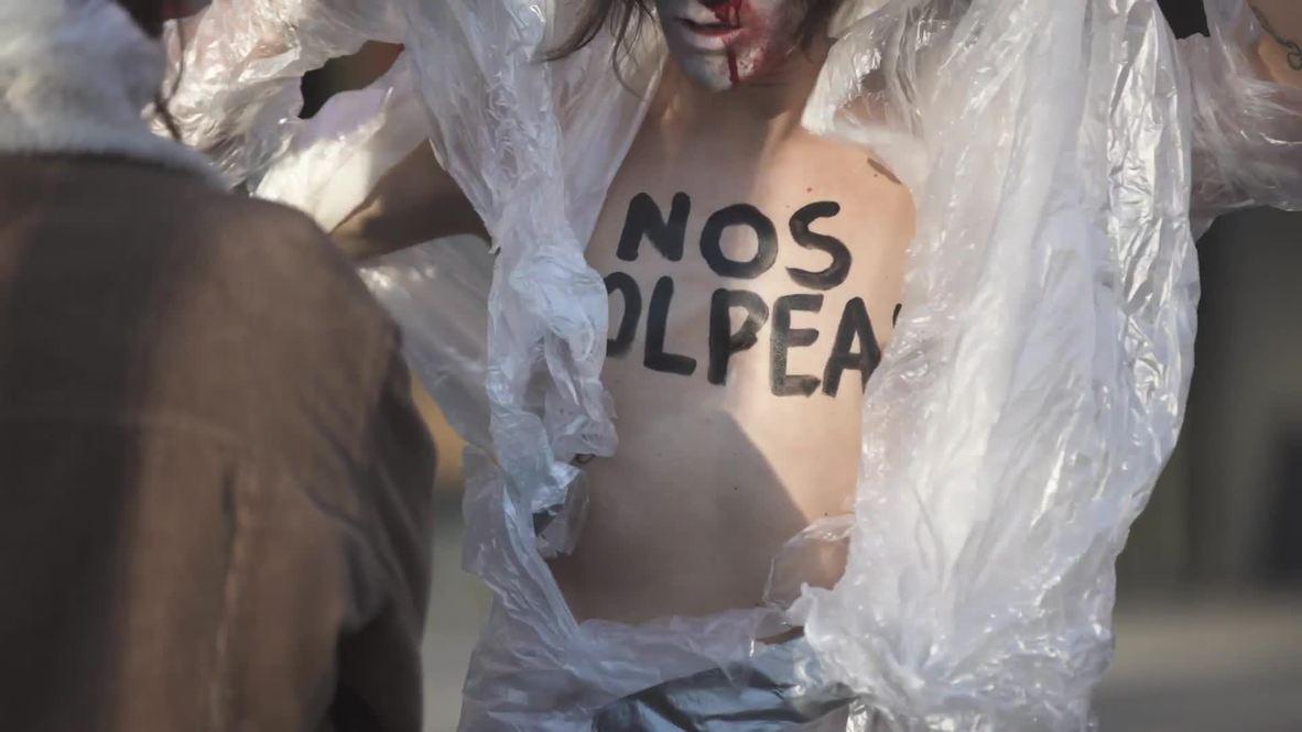 Spain: Topless FEMEN activists decry violence against women in Madrid *EXPLICIT*