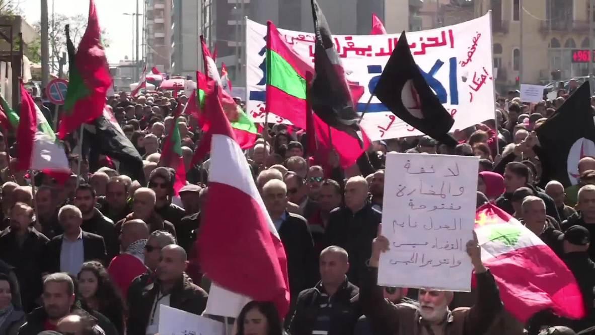 Lebanon: Hundreds join leftist Beirut march against Hariri's govt.