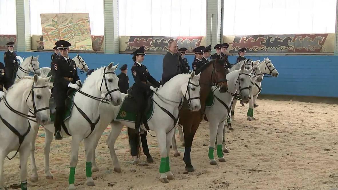 Horsing around! Putin shows off horse-riding skills during police regiment visit