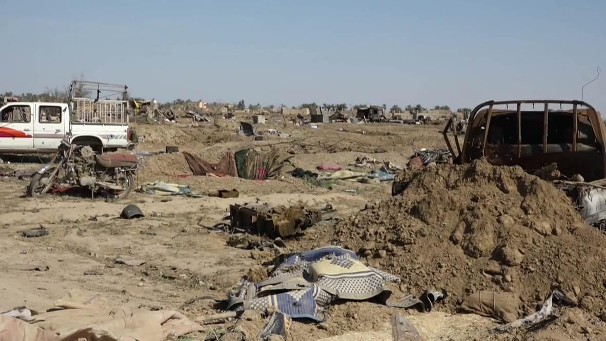 Сирия: Лагерь ИГ(*) в окрестностях Багуза лежит в руинах после освобождения деревни