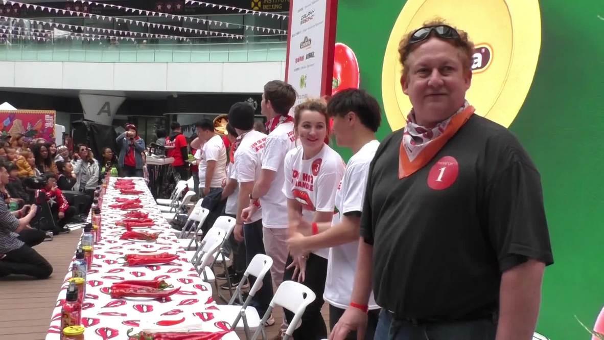 'Veni, vidi, vici'- Americano gana el concurso de chile picante Hot & Spicy de Pekín