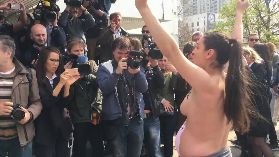 Ukraine: 'Stop raping our country' - FEMEN activist protests outside Zelenskiy polling station *EXPLICIT*