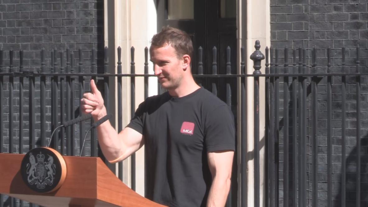 Hot 'podium guy' upstages Theresa May's resignation speech