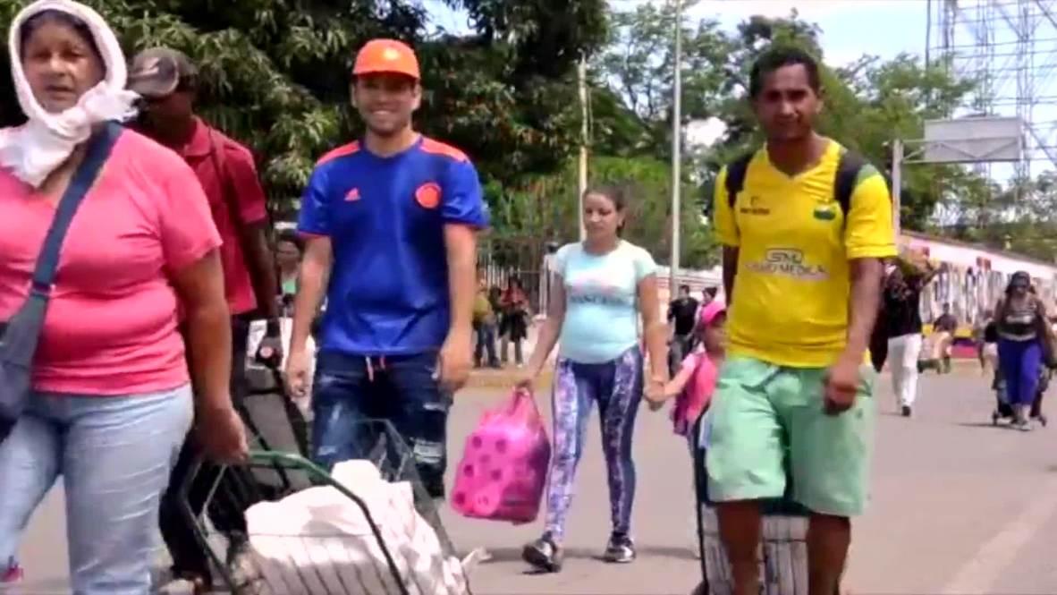 Venezuela: Crowds from both sides cross reopened Colombia–Venezuela border