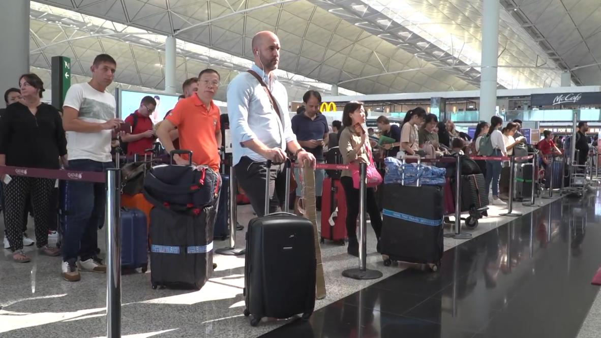 Hong Kong: Flights resume after violent clashes at the airport