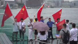Hong Kong: Pro-government demonstrators wave China's flag at rally