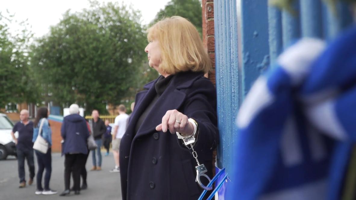 UK: Ex-Bury FC director handcuffs herself to railings outside stadium