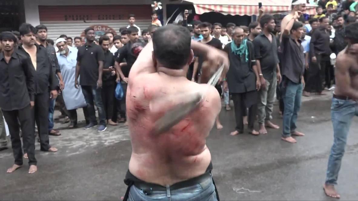India: Shia Muslims mark Ashura by self-flagellating in Hyderabad *GRAPHIC*