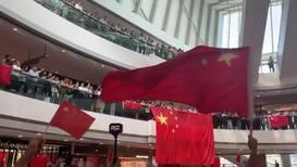 Hong Kong: Pro-Beijing demonstrators wave Chinese flags at HK mall