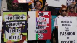 UK: Extinction Rebellion activists protest outside London Fashion Week venue