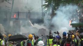 Hong Kong: Molotovs hurled at police station on anti-govt march