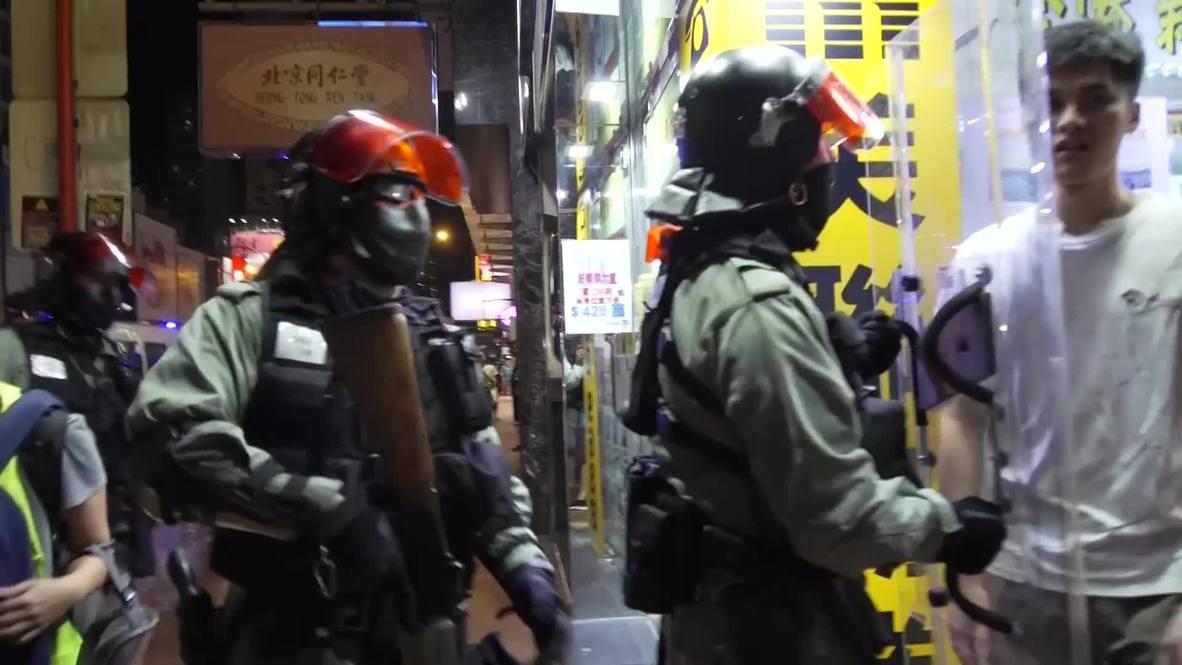 Hong Kong: Police disperse Yuen Long attack memorial sit-in