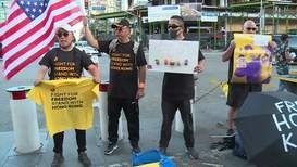 USA: Activists hand out 'Stand with Hong Kong' T-shirts at NBA opener
