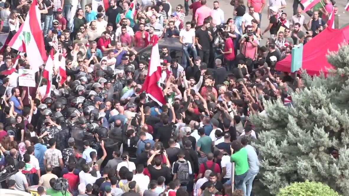 Líbano: Policía antidisturbios dispersa a manifestantes mientras estallan enfrentamientos