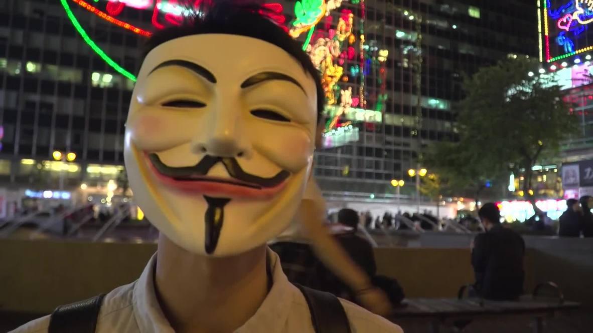 Hong Kong: Guy Fawkes inspires protesters to defy face mask ban