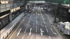 Hong Kong: Protesters disrupt traffic, blockade central road in financial hub