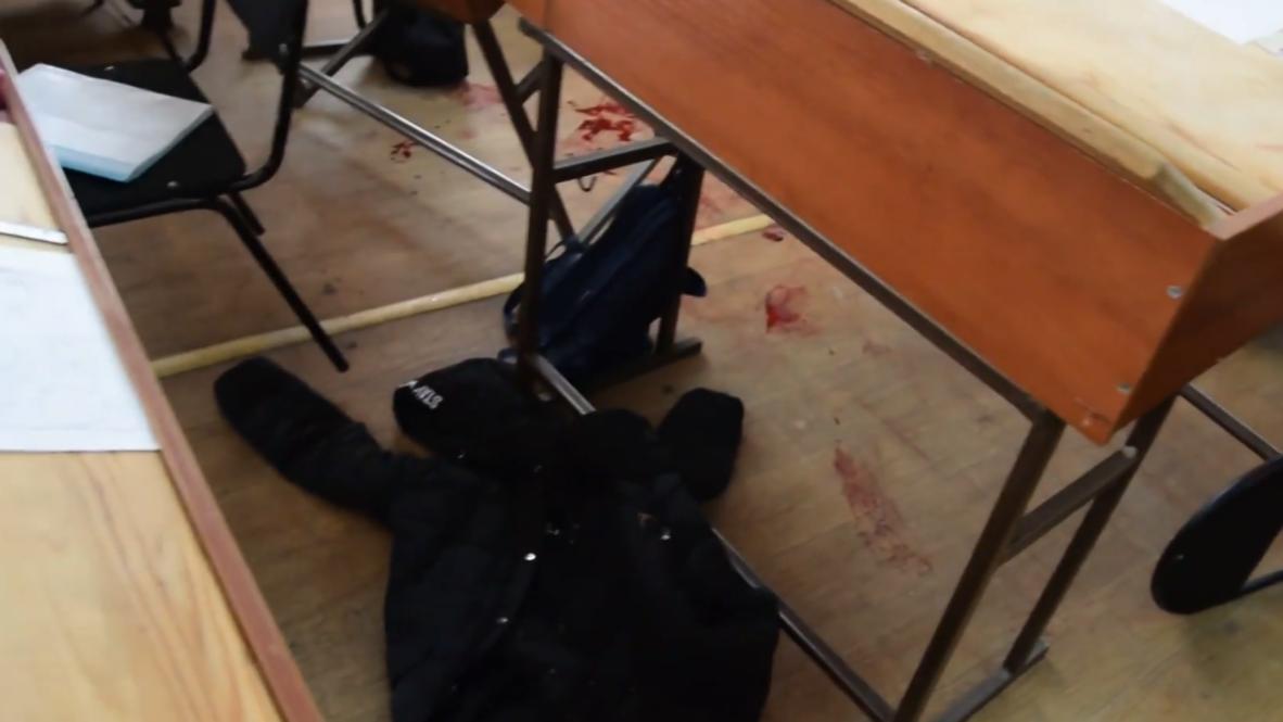 Россия: Кровь и гильзы – следователи проводят осмотр на месте стрельбы в колледже