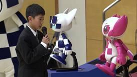 Japan: Tokyo 2020 mascot robots visit elementary school