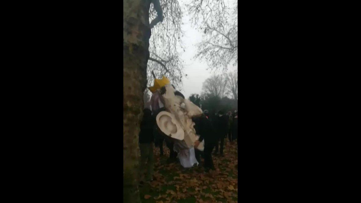 France: Protesters smash Macron pinata in Nantes