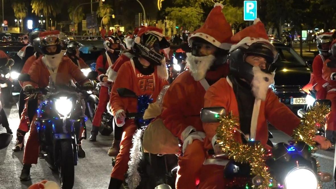 Spain: No sleigh! Thousands of gift-laden biker Santas flood Barcelona