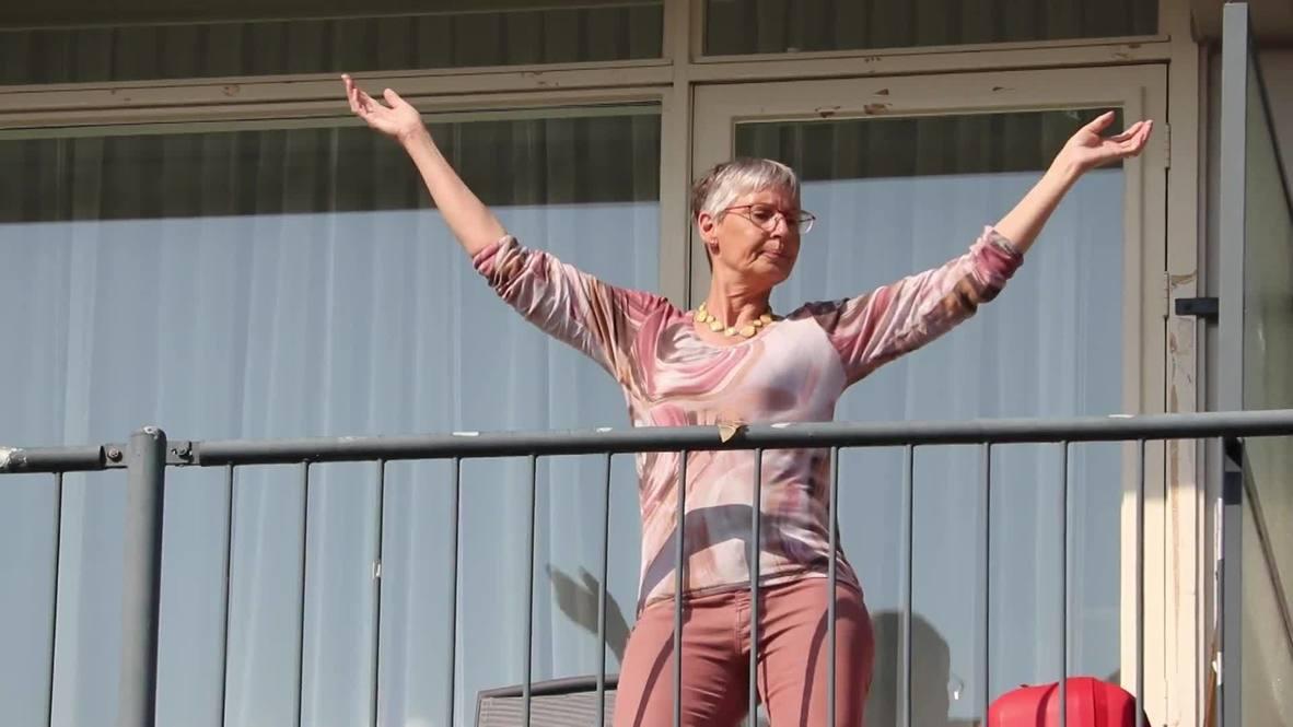 Dutch nursing home residents and their relatives perform 'corona-proof' dance amid quarantine