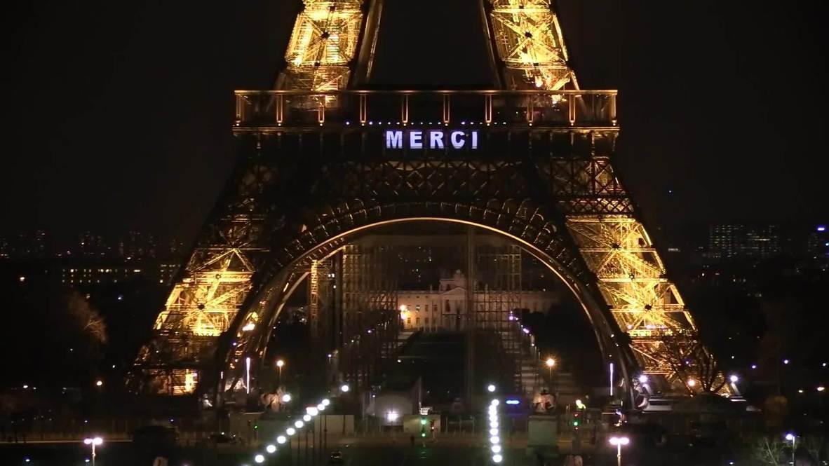"""С Эйфелевой башни просят: """"Оставайся дома"""". Парижанам напомнили о необходимости изоляции"""