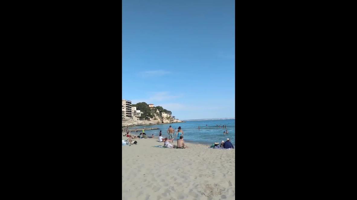 España: Amantes de la playa disfrutan del sol mientras Mallorca entra en la fase 2 de desescalada