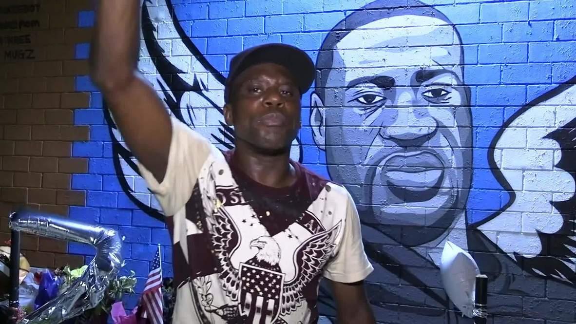 США: На стенах зданий в Хьюстоне появились граффити с изображением Флойда