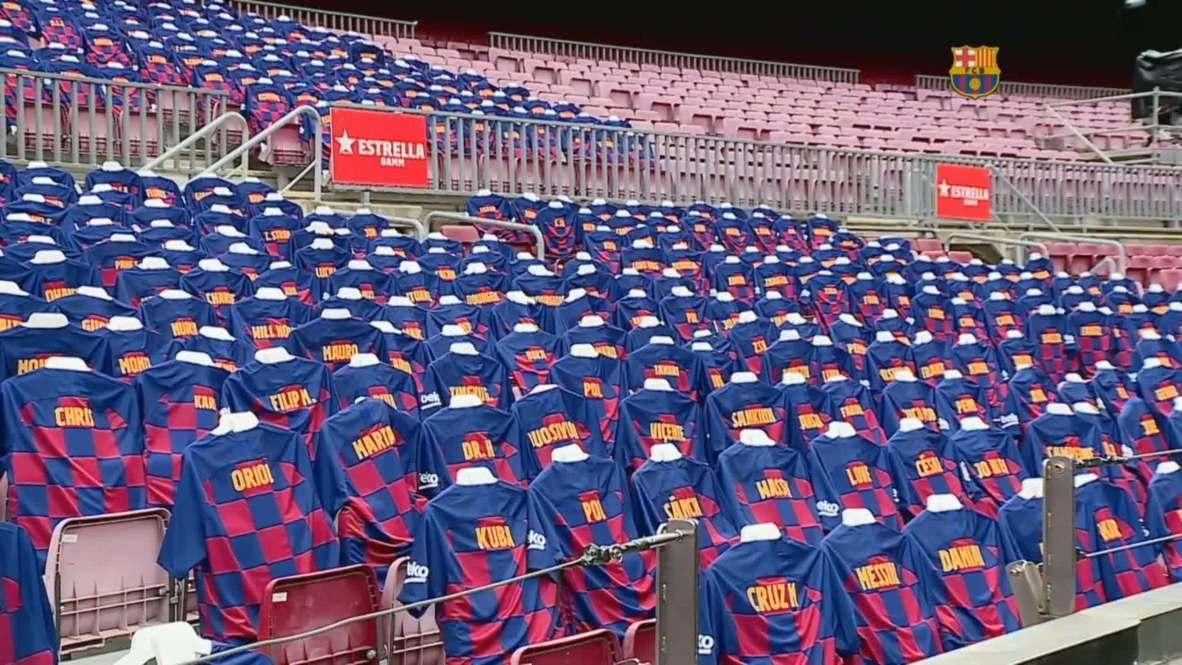 España: Los seguidores 'culés' asisten simbolicamente al Camp Nou contra el Atlético de Madrid