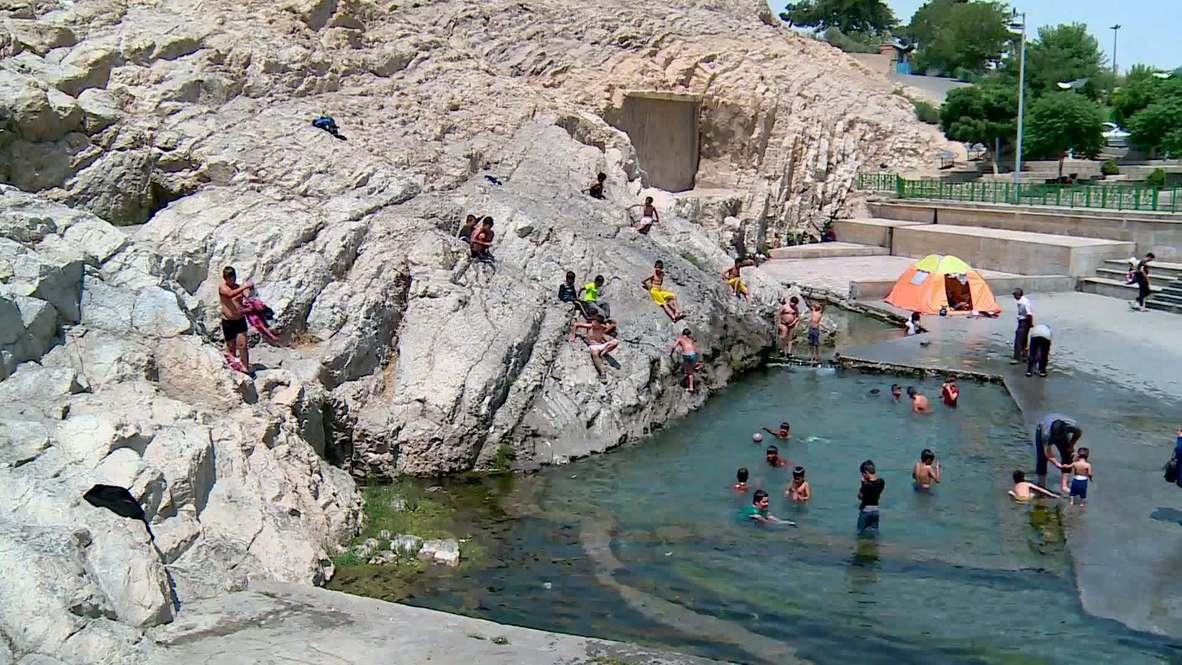 Iran: Tehranis beat the heat at ancient spring despite coronavirus fears