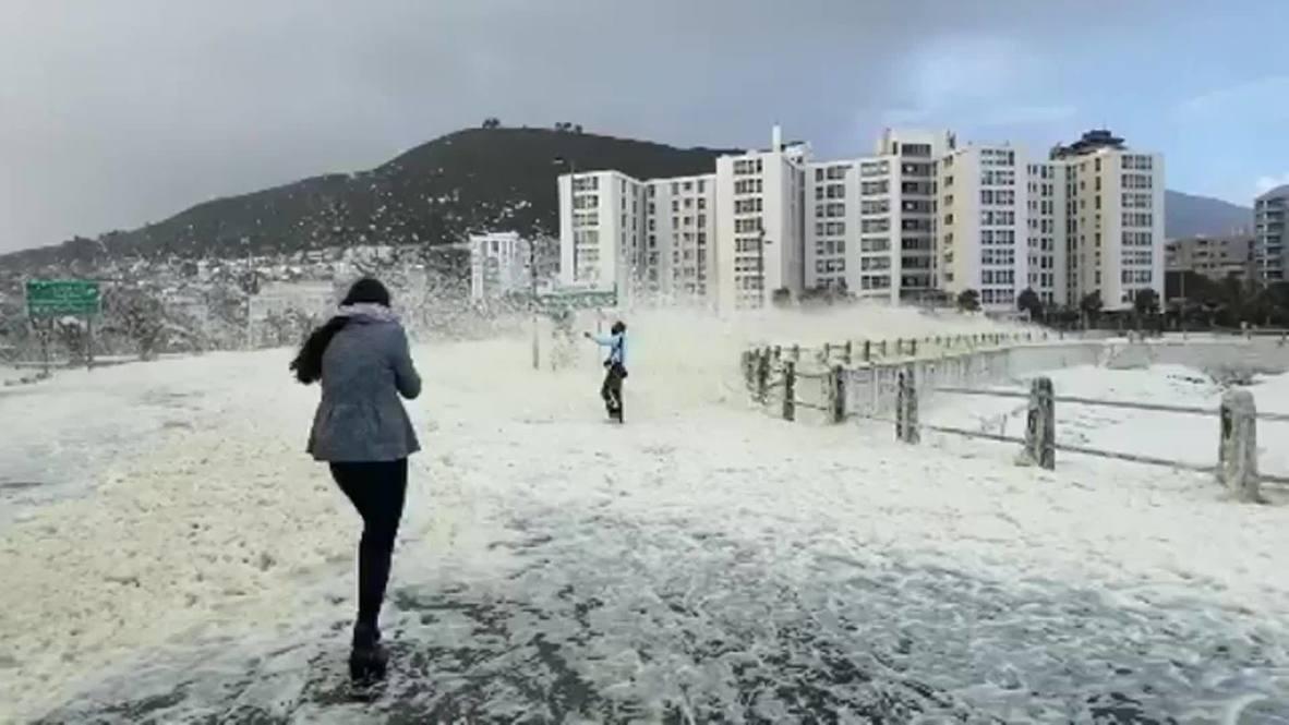 South Africa: Sea foam and heavy winds create 'snowy' scene in Cape Town