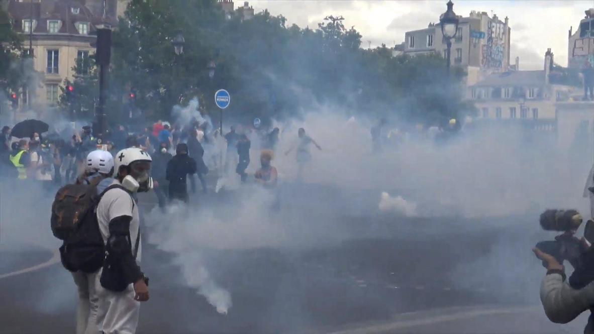 France: Tear gas flies as Bastille Day demo turns violent in Paris