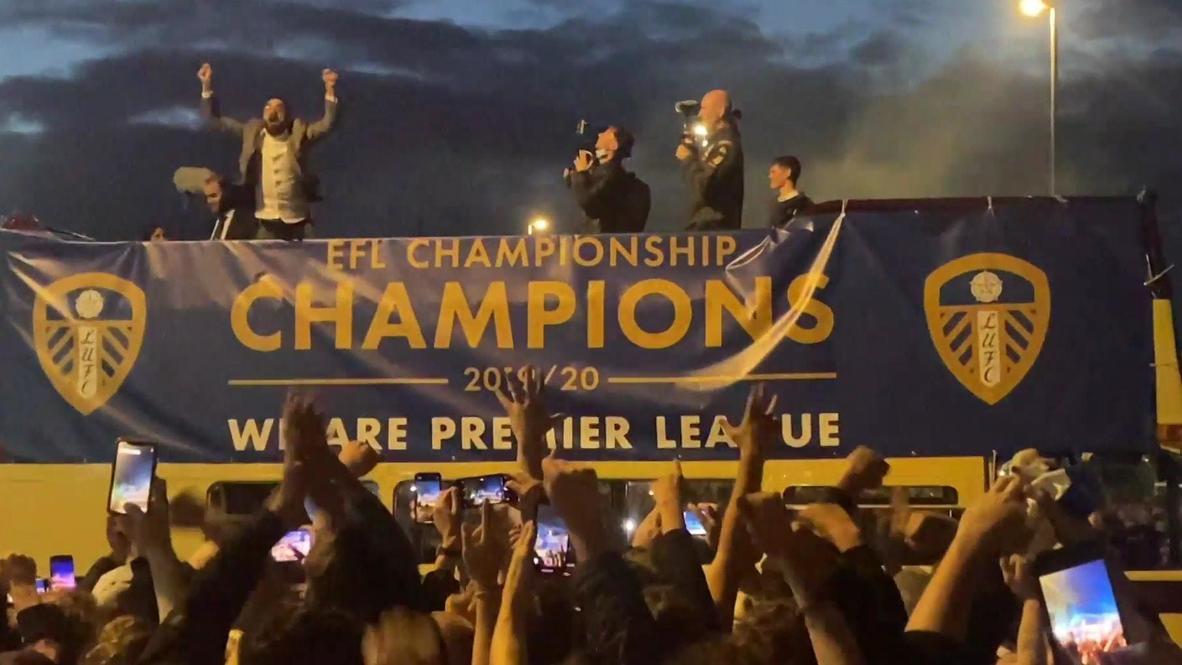 UK: Fans celebrate despite COVID warning as Leeds Utd party on open-top bus