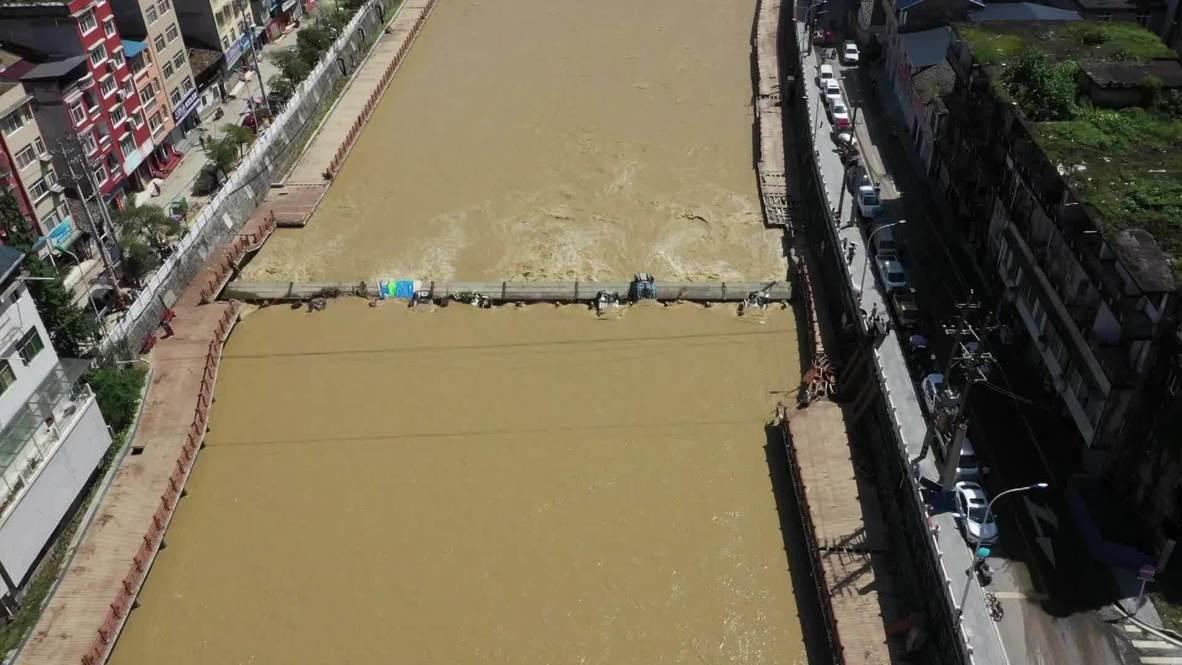China: Emergency response level raised to highest as floods hit Enshi