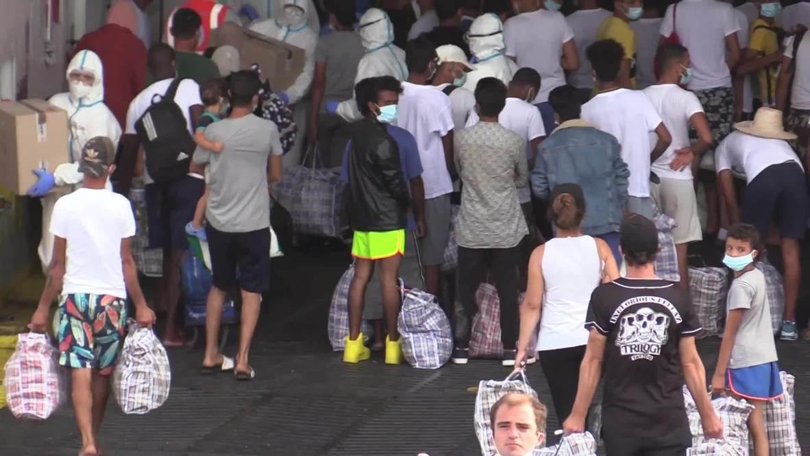 Italy: Migrants board GNV Azzurra vessel for mandatory quarantine in Lampedusa