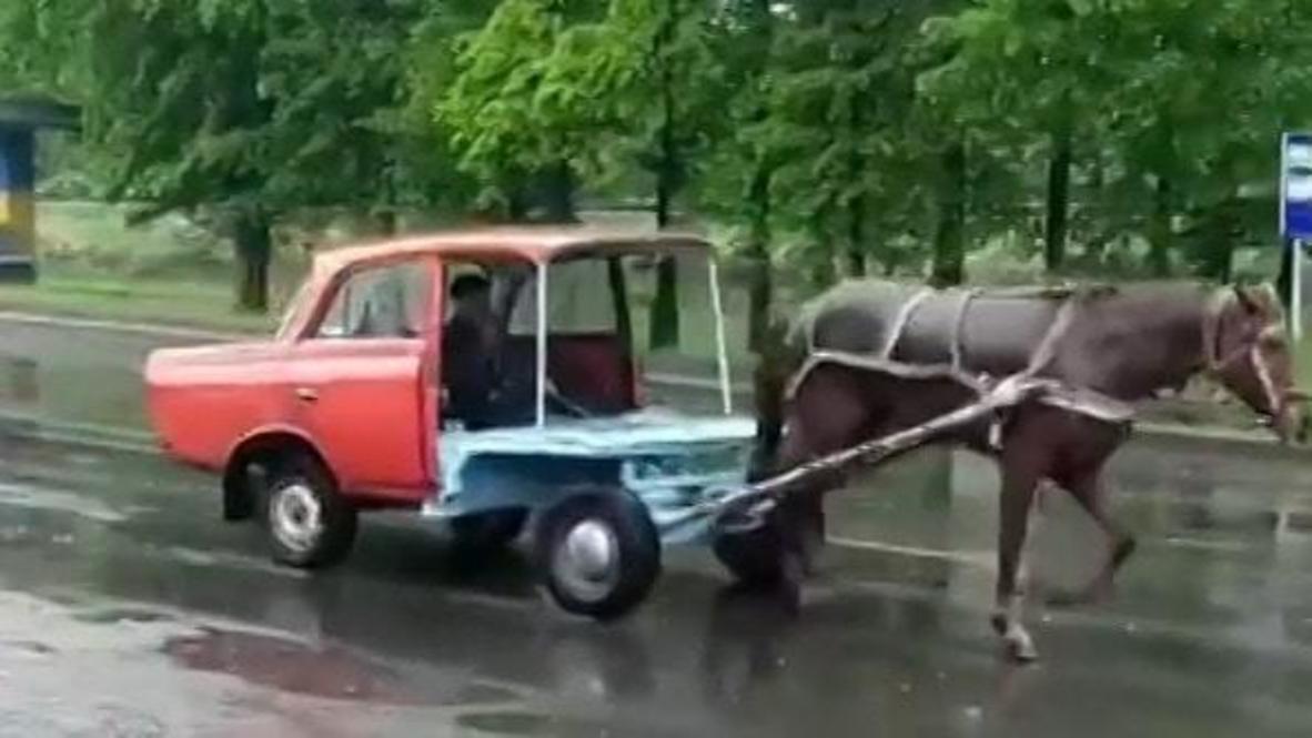 Ukraine: Elderly couple shock passersby with literal soviet horse-powered car