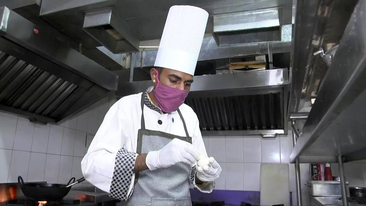 مطعم هندي يقدم أطباقاً على شكل فيروس كورونا وقناع وجه لجذب الزبائن بعد فترة الإغلاق الشامل