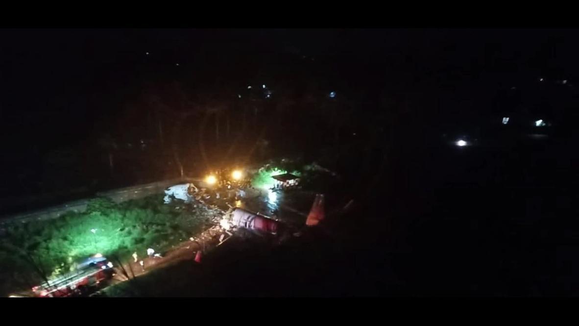 India: Emergency services work at scene of plane crash *STILLS*