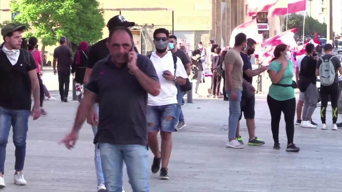 """لبنان: """"إسقاط النظام الفاسد برمته"""".. البيروتيون يردون على استقالة رئيس الوزراء دياب"""