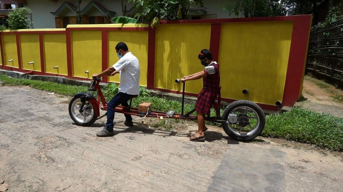 """أب يصنع دراجة نارية بشروط """"التباعد الاجتماعي"""" لاصطحاب ابنته إلى المدرسة"""