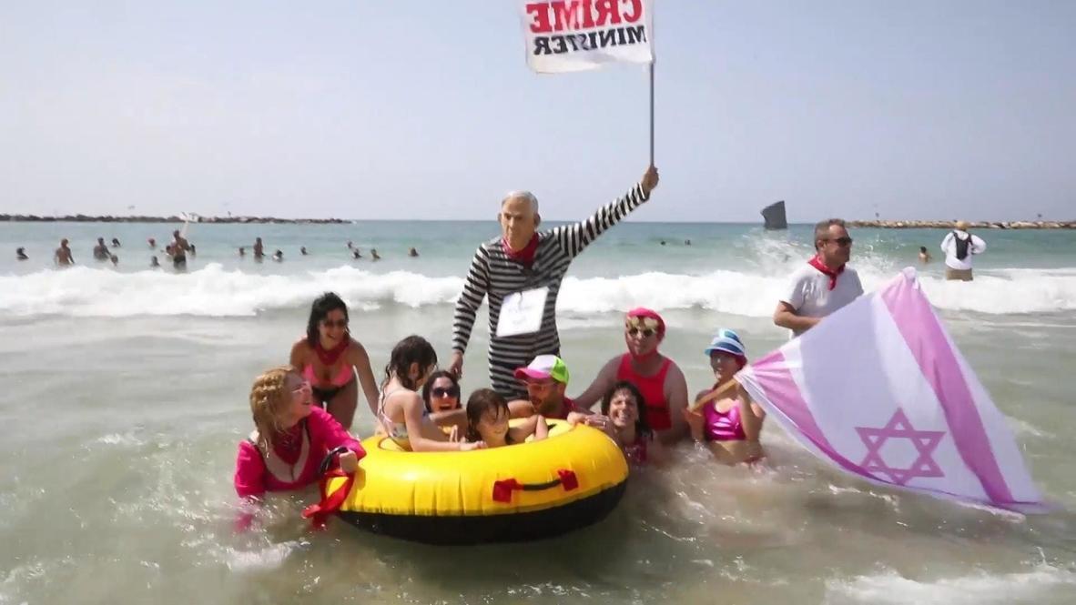 Israel: Manifestantes protestan en la playa de Tel Aviv contra segundo confinamiento por covid-19