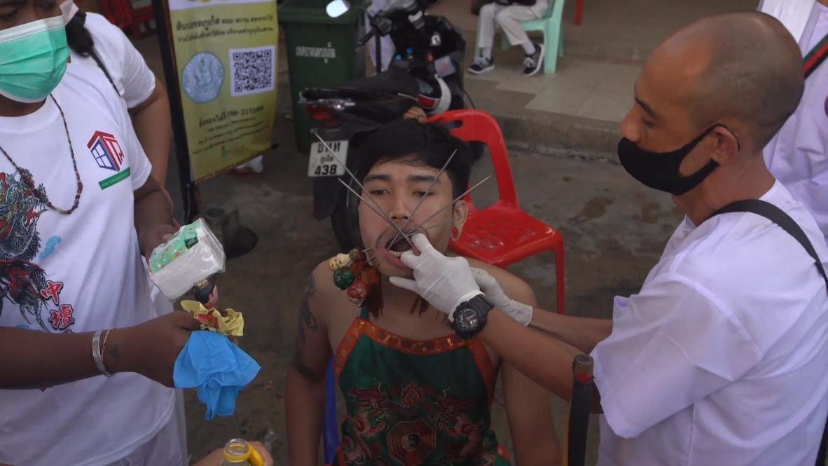 Thailand: Devotees pierce their flesh with skewers at Phuket vegetarian festival *GRAPHIC*