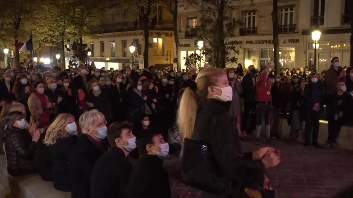 France: Hundreds pay tribute to murdered teacher outside Paris's Sorbonne university
