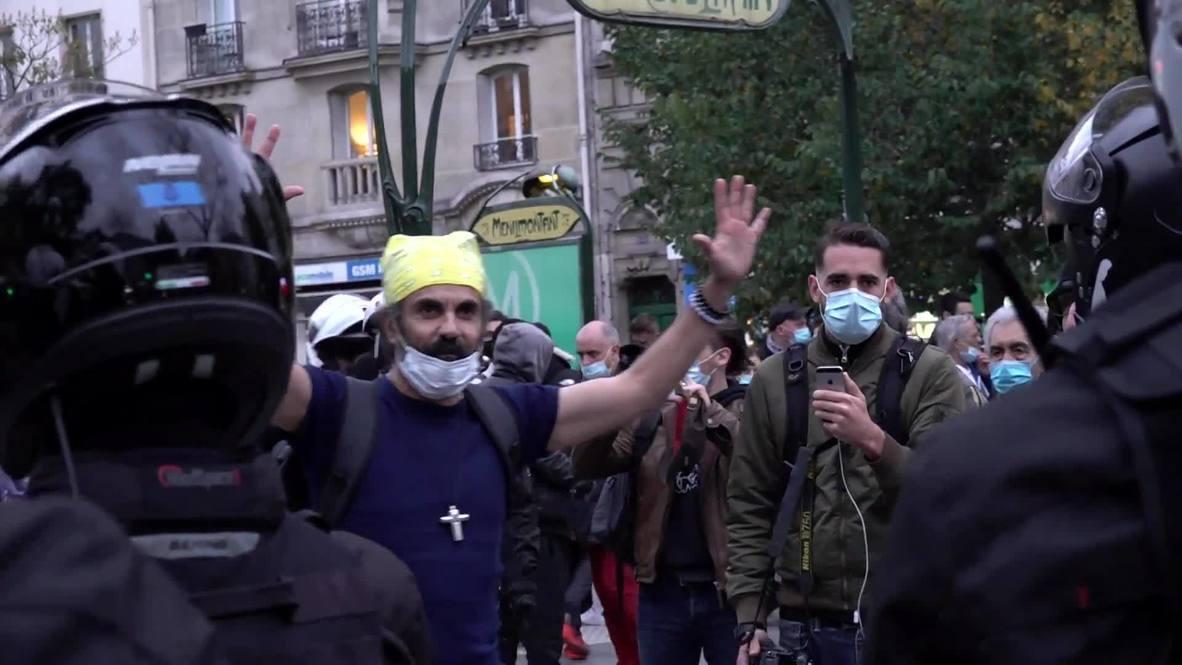 Francia: Residentes de París protestan contra las restricciones por covid-19
